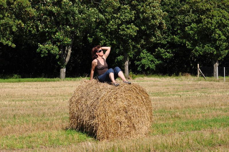 Woman relaxing on grassy field