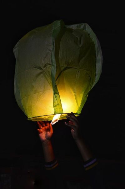 Sky Lantern Celebration Event Hands Air Lift Fly Sky Night Black Background Yellow Multi Colored Hot Air Balloon EyeEmNewHere