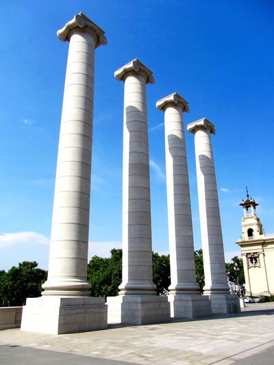 The Four Pillars symbolising the Catalan Flag outside of the National Palace of Barcelona - Barcelona, Spain. Architecture Low Angle View Architectural Column Sky Blue Built Structure Travel Destinations History Outdoors Building Exterior Clear Sky Day Monument No People Barcelona Barcelona, Spain Catalan Pillars