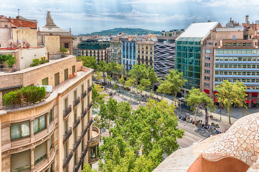 BARCELONA - AUGUST 9: Aerial view of Passeig de Gracia from Casa Mila, aka La Pedrera, in the Eixample district of Barcelona, Catalonia, Spain, on August 9, 2017 Architecture Building Exterior Built Structure City Tree Building Plant Nature Sky High Angle View Day Residential District Cloud - Sky No People Outdoors Travel Destinations Travel Water