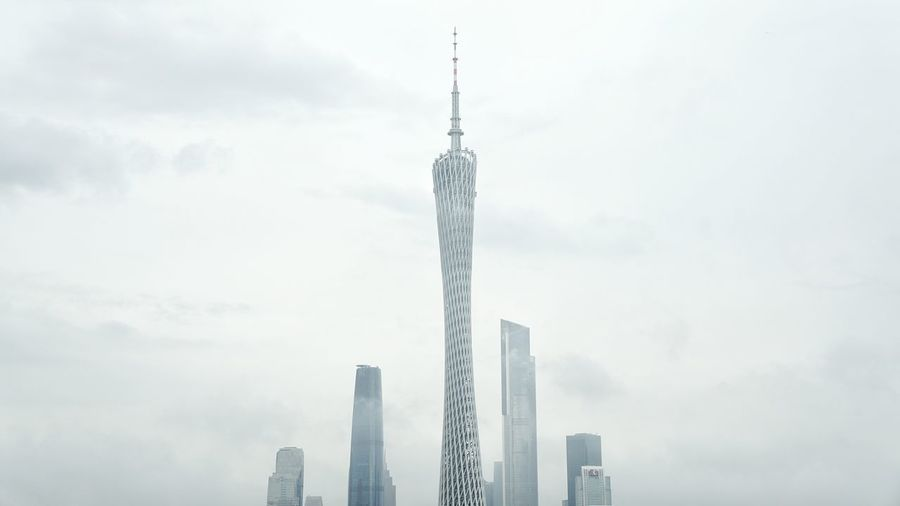 Low angle view of canton tower against sky in city