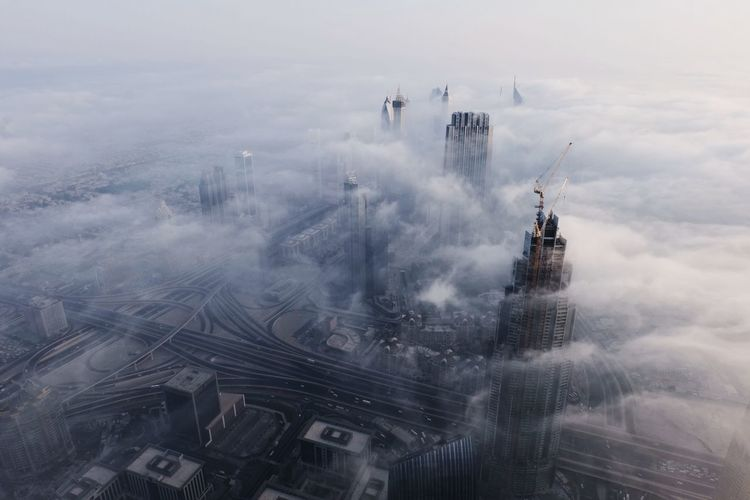 Aerial View Of Buildings Surrounded By Clouds Seen Through Burj Khalifa