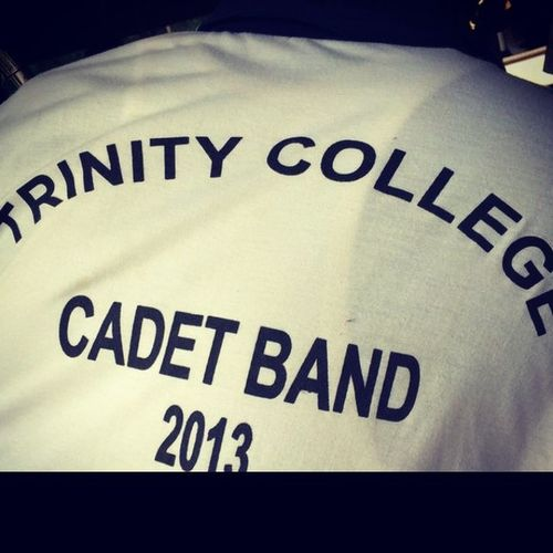 Trinity_college_cadet_band hail who march under the standard of LIONS