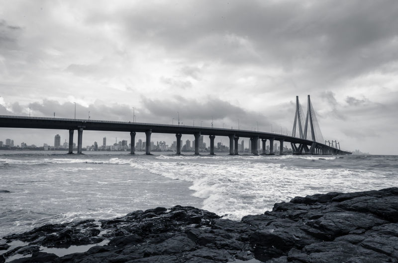 A view of Bandra-Worli Sea Link in Mumbai on an overcast day. India Mumbai Travel Architectural Column Architecture Bandra Worli Sea Link Beauty In Nature Bridge Bridge - Man Made Structure Built Structure Cloud - Sky Connection Day Landmark Nature No People Outdoors Overcast Scenics - Nature Sea Sky Tranquility Transportation Travel Destinations Water