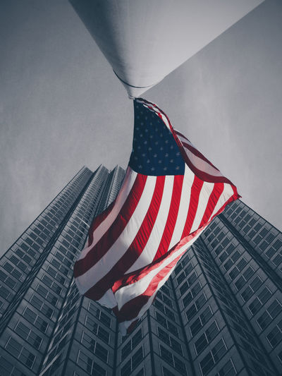 Low Angle View Of American Flag And Building