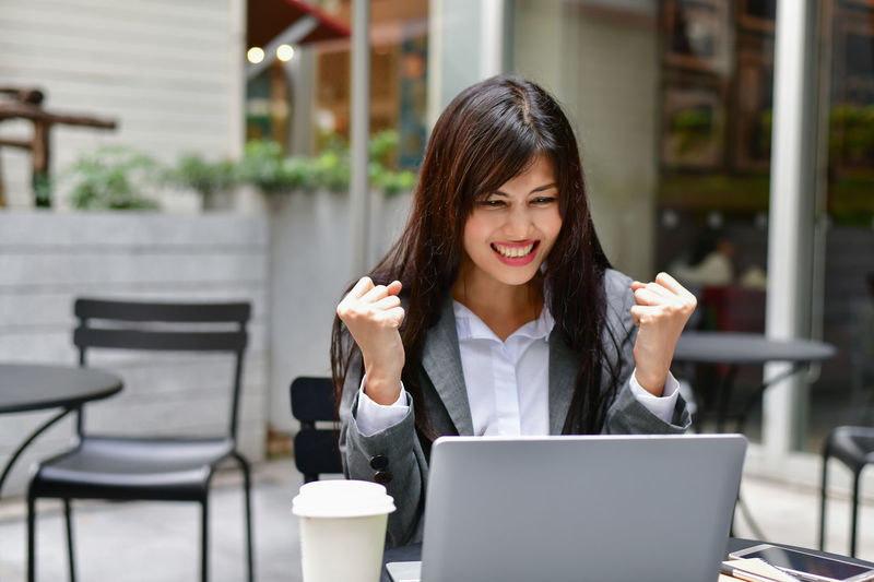 Adult Beautiful Woman Business Coffee Coffee - Drink Communication Computer Connection Food And Drink Front View Hair Hairstyle Laptop Long Hair One Person Sitting Technology Using Laptop Wireless Technology Women Young Adult Young Women