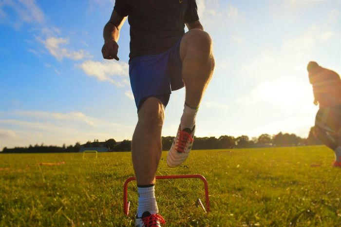 Football training, fitness Sports Training Football Player Football Training Fitness Training Summertime Preseason Low Angle View Addidas Boots Step Over Ladder Work Open Fields
