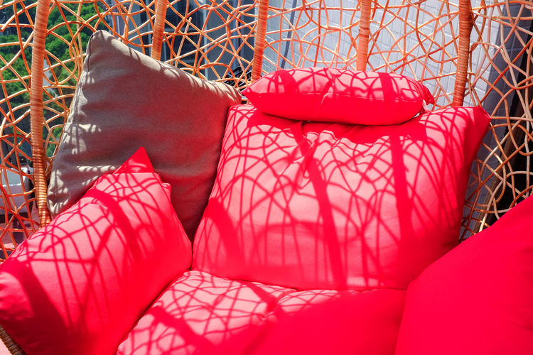 Close-Up Of Red Cushions