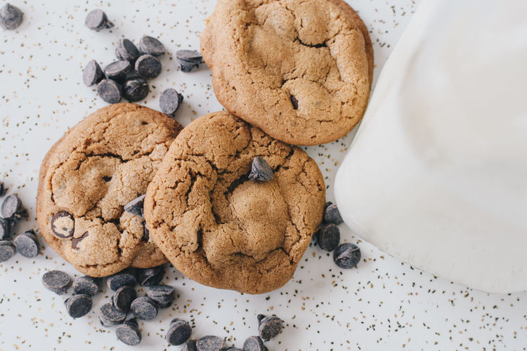 Close-Up Of Cookies With Milk On Table