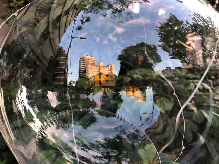 Digital composite image of buildings and trees in city