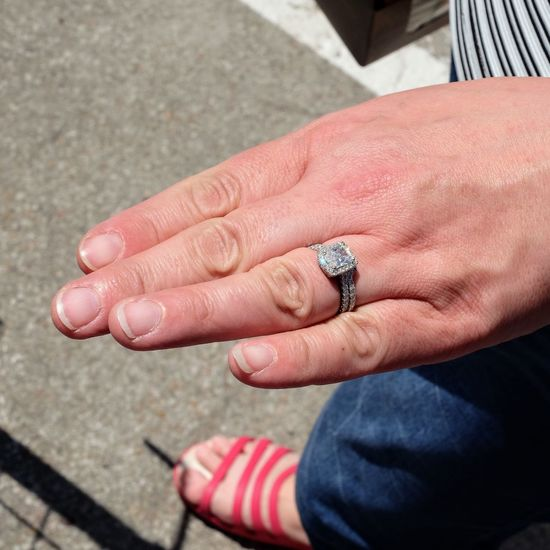 Low section of woman wearing ring