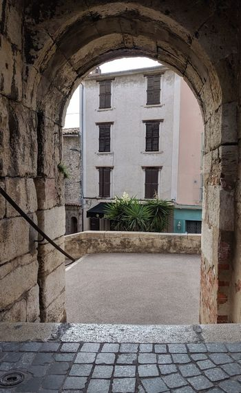 Footpath by wall of building