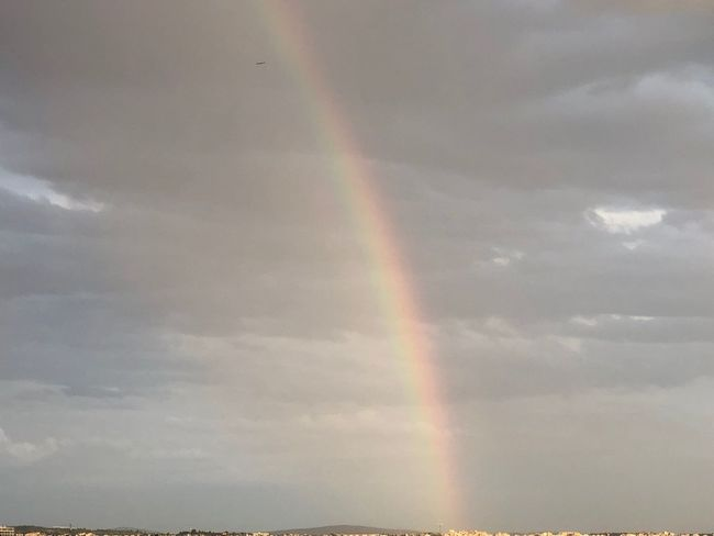A part of a rainbow in the sky Greece Thessaloniki Rainbow Cloud - Sky Sky Beauty In Nature Scenics - Nature Multi Colored No People Nature Tranquility Double Rainbow Low Angle View Tranquil Scene Outdoors Day Idyllic Natural Phenomenon Water Non-urban Scene Meteorology Environment