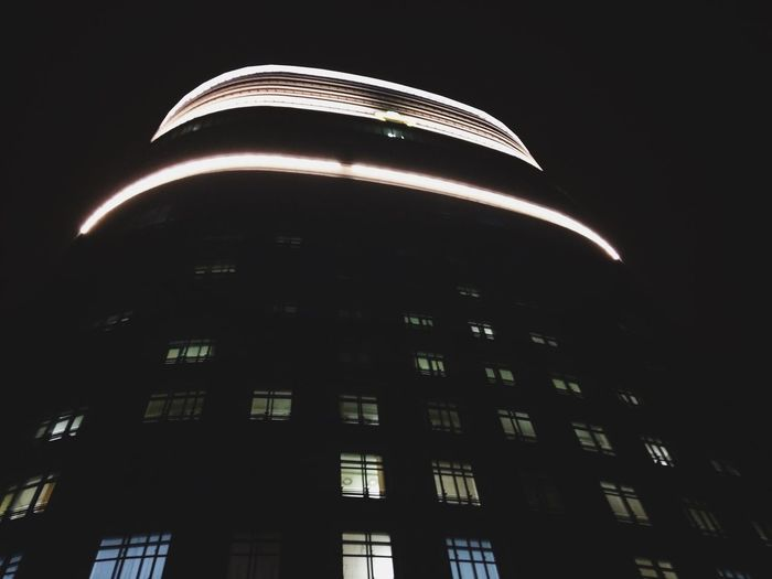 Low angle view of illuminated building against sky at night