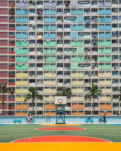 Cool Rainbow Coloured Apartment in Hong Kong Group Of People Tree Real People Window Incidental People Outdoors Nature Residential District City Plant Architecture Building Day Building Exterior Built Structure Sport Apartment People Court Hong Kong colour of life Colourful Colors Rainbow