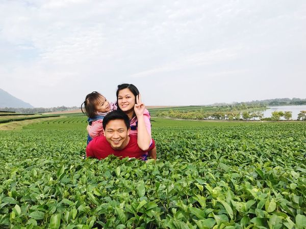 Mother and daughter ride piggyback father Outdoors Togetherness Warm Smile Happy Family Childhood Plant Child Field Family Togetherness Real People Portrait Land Sky Looking At Camera Nature Bonding Green Color Positive Emotion Emotion Women Girls Females Group Of People