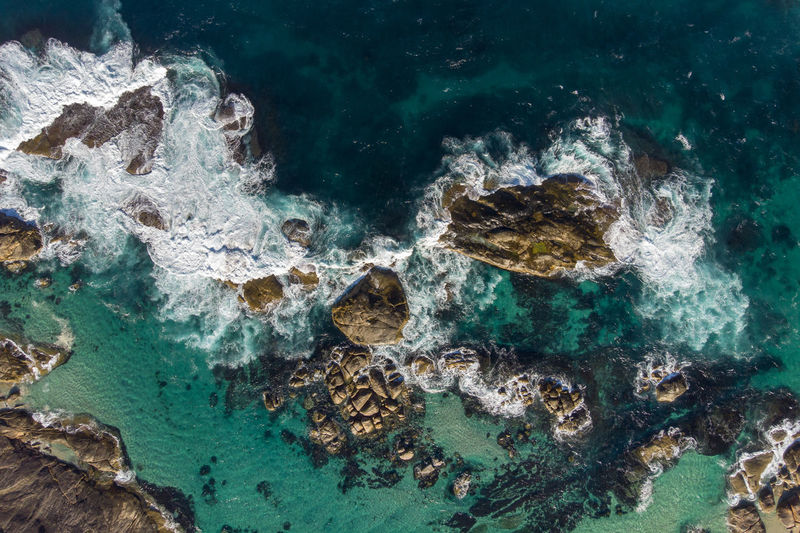 Aerial view of wave swell and rocks. Clear Sky Nature Swell Wave Western Australia Aerial Photography Aerial View Beauty In Nature Day Marine Nature No People Ocean Outdoors Rock Rock - Object Sea Sea Life Seascape Solid Top Down View Turquoise Colored UnderSea Underwater Water