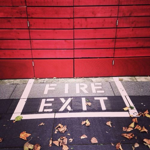 Fire exit of red wooden building