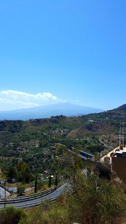 Mountain View Of Taormina Italy Travel Destinations Vacation Time Beautiful Day Tourism Tourist Attraction  Taormina Italy History Through The Lens  Taormina Italia Beautiful Place Mountain View Europe Landscape Sky No People Outdoors Agriculture Day Mountain Beauty In Nature Nature Clear Sky