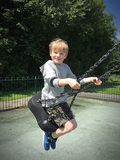 . Boy On A Swing Playing Outside Park Playground Fun Swing Summer Fun ☀️ Happiness Childhood