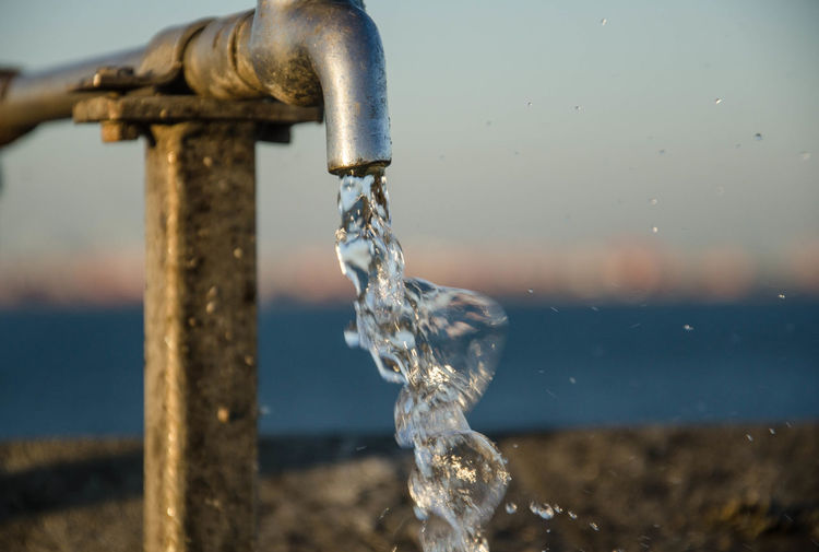 Close-up of water flowing from tap