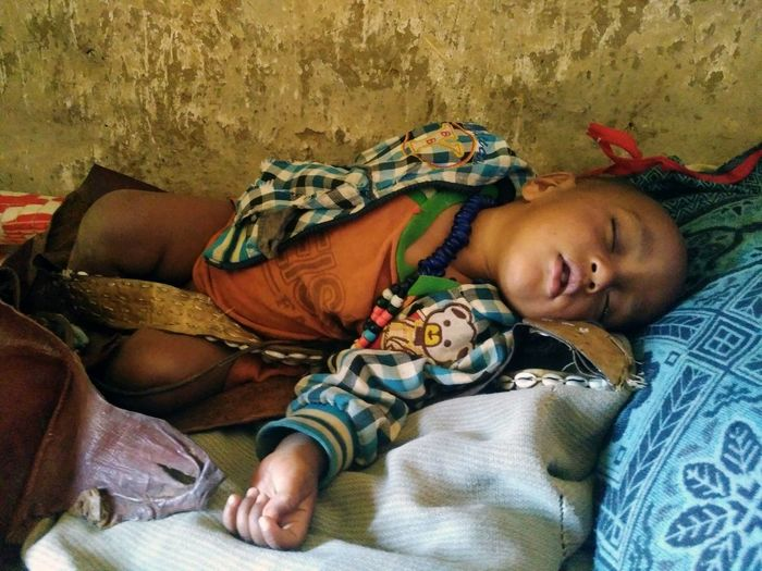 This picture as been taken during a workshop. The aim was to plan the development of small villages. Sleeping Ethiopia Children Sleeping Children Africa Tigray Lying Down Eyes Closed  Resting One Person Lying On Back Napping