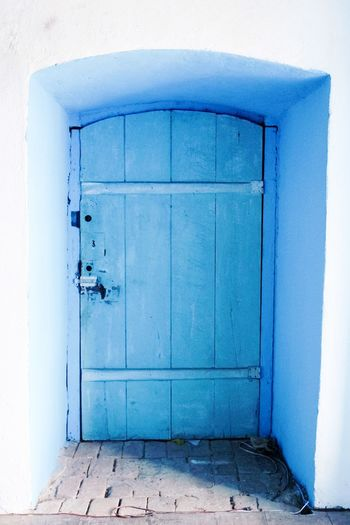 Door in Brazil EyeEm Best Shots EyeEmNewHere Street Photography The Week on EyeEm EyeEm Selects Light And Shadow Door Blue Architecture Built Structure Doorway No People Day Outdoors Building Exterior Colour Your Horizn