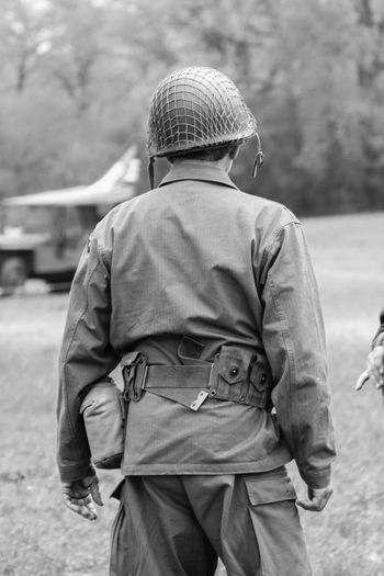 Rear view of army soldier on field