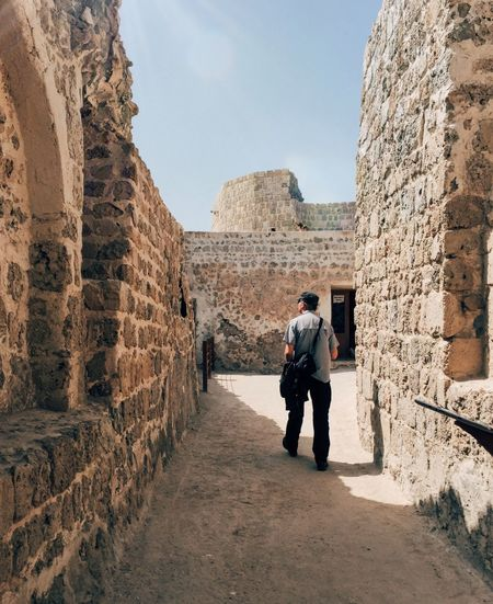 Full length of man walking amidst old ruin