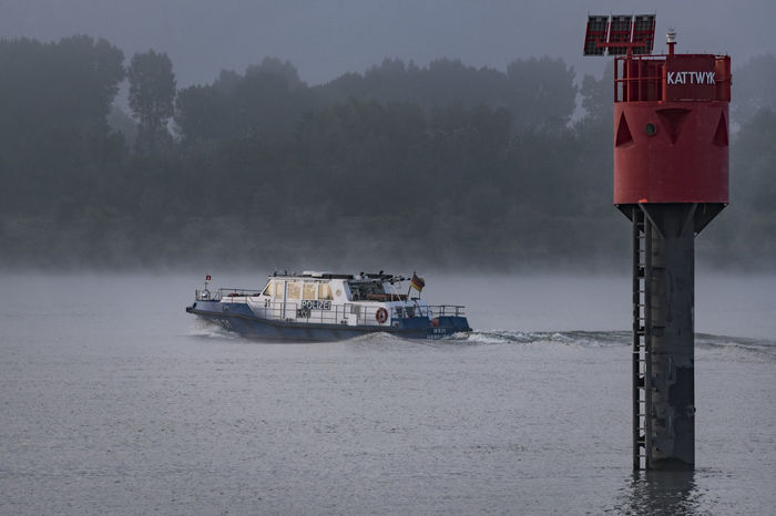 Police boat Cloud - Sky Foggy Morning Hamburg Harbour Morning Light Nature No People Non-urban Scene Outdoors Policeboat Remote Riverbank Scenics Shore Signboard Sky Solitude Standing Water Tranquil Scene Tranquility Transportation Tree Water Waterfront