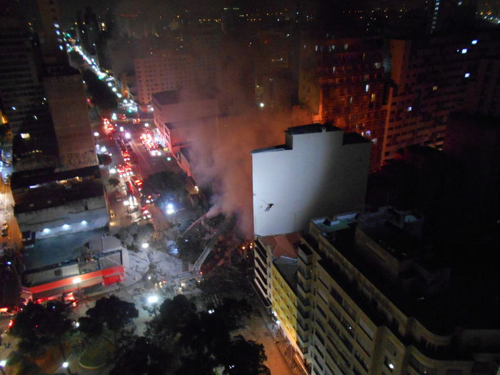 Building Collapse: Inner City Calamity in downtown São Paulo at Largo do Paissandú; 3 am May 1, 2018. The abandoned former Federal Police steel and glass skyscraper, which had been invaded by street people, imploded this early morning and the neighboring building has caught on fire as well. This photo taken between 4 am to 5 am, May 1, 2018 at Largo do Paissandú. Current Events Destruction Destruction Can Be Beautiful Largo Do Paissandu May 1, 2018 Night Photography Susan A. Case Sabir The Week on EyeEm Unretouched Photography About 4 Am Building Collapse Building Fire Building Implosion Burning Building Controlled Chaos Dangerous Situation Downtown São Paulo Helicopters Overhead High Angle View Responsiveness Smoke - Physical Structure Unexpected Event Urban Photography Urban Strife Focus On The Story