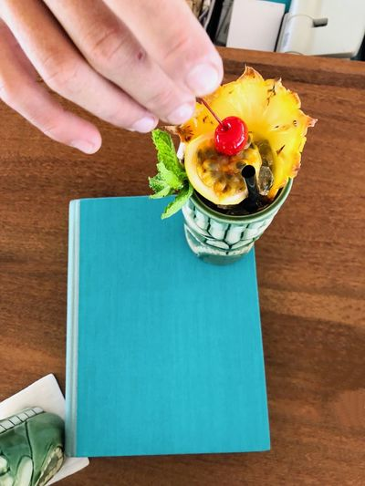 High angle view of person holding food on table
