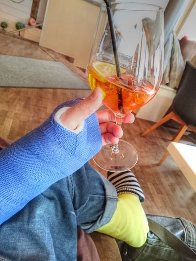 Leg Cast Alcohol Arm Cast Armcast Body Part Broken Arm Broken Leg Brokenarm Brokenleg Cocktail Drink Focus On Foreground Food And Drink Freshness Glass Hand Holding Human Body Part Human Hand Indoors  Jeans Legcast Lifestyles Men One Person Real People Refreshment Wine