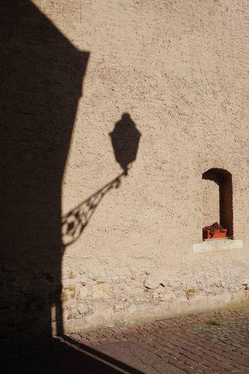 Shadow of cross on wall