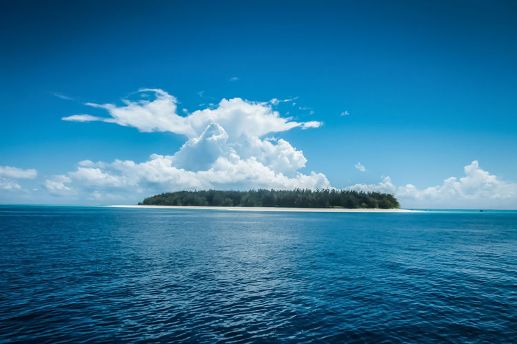 Tropical island in horizon Sky Water Scenics - Nature Cloud - Sky Tranquil Scene Beauty In Nature Tranquility Sea Blue Waterfront Horizon Idyllic No People Island Seascape Outdoors Horizon Over Water Nature Day