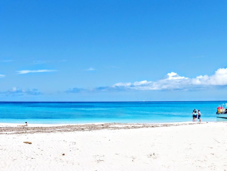 Beach Sea Sand Blue Sky Horizon Over Water Nature Day Scenics Beauty In Nature Water Turks And Caicos Real People Cloud - Sky Vacations Tranquility Outdoors Two People Men Lifestyles Full Length Heaven Heaven On Earth Heavenly Sky Grace Beach