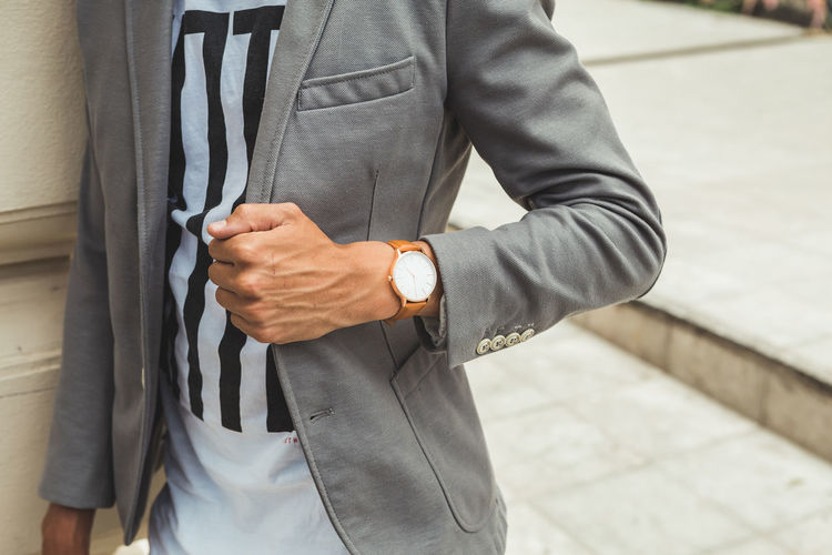 Young Man in Suit Wearing Analog Watch in the Urban environmen One Person Watch Midsection Time Real People Wristwatch Focus On Foreground Day Standing Men Holding Lifestyles Human Hand Well-dressed Hand Leisure Activity Outdoors Clothing Casual Clothing Checking The Time Wrist Watch Jewellery Jewelry Young Adult Young Men City City Life Urban Street