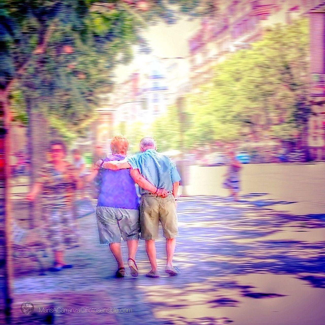 walking, real people, rear view, two people, togetherness, women, full length, lifestyles, senior women, men, leisure activity, blurred motion, outdoors, senior adult, day, motion, bonding, senior couple, water, nature, sky, adult, people