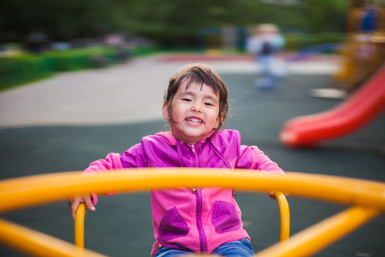 Portrait of smiling girl playing in park