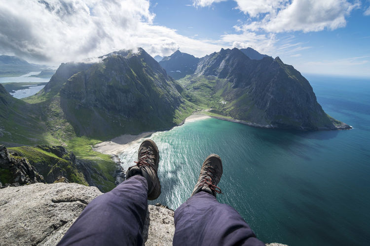 Low Section Mountain Human Leg Personal Perspective Scenics - Nature Beauty In Nature Water Human Body Part Nature Shoe Men Outdoors Human Foot Mountain Range Cloud - Sky EyeEm Best Shots EyeEmNewHere EyeEm Nature Lover Cliff Norway Lofoten Lofoten Islands Ryten Beach Dangerous