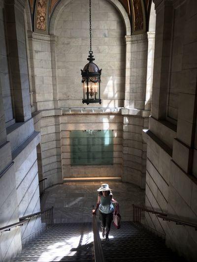 Woman in corridor of temple