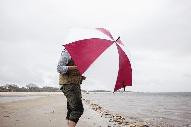 Lamu island. Water One Person Sea Sky Umbrella Land Beach Rain