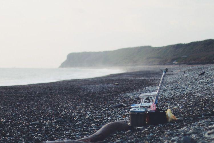 Empty Chair At Beach Against Clear Sky