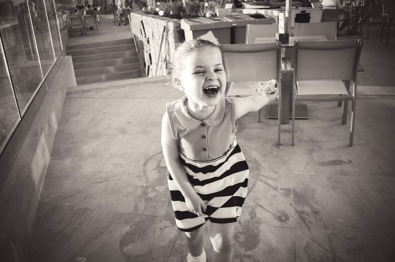 Portrait of laughing girl in restaurant