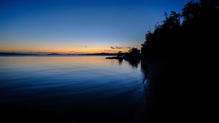 """""""Breaking dawn"""" A beautiful sight. Beautiful Colors Morning Quiet Relaxing Ripples Beauty In Nature Dawn Maraetai Nature New Zealand No People Outdoors Picturesque Reflection Scenics Sea Sillouette Sky Sunrise Tranquil Scene Tranquility Tree Water Waterfront"""