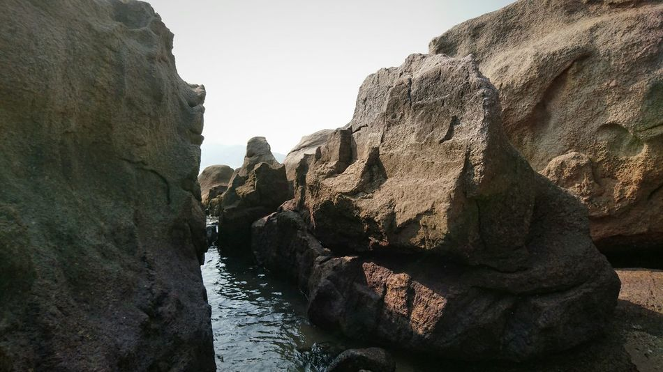 Adults Only One Person Nature Adult Only Women Close-up Day One Woman Only People Human Body Part Human Hand Beauty In Nature Outdoors Sky Sunlight Rock - Object Textured  Cheung Chau Textured  Hong Kong Rocks Formation Of Nature Beauty In Nature Landscape Textured