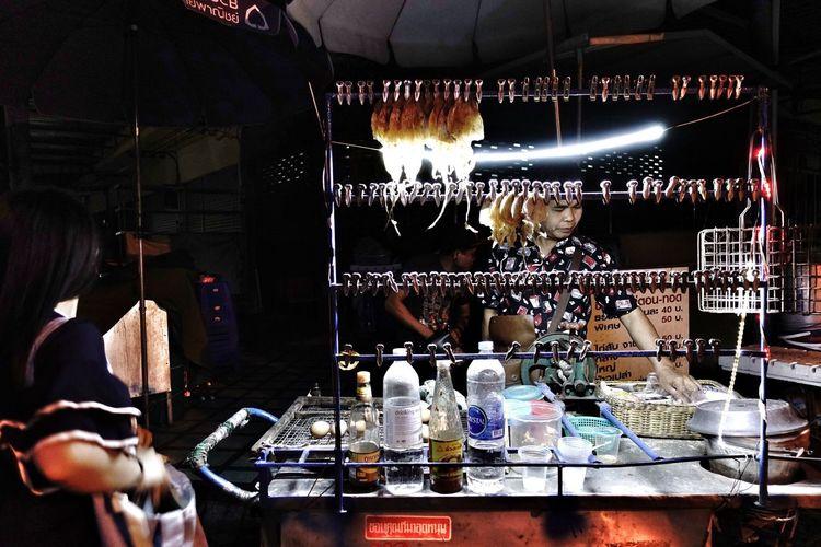 Full length of illuminated lighting equipment on display at store