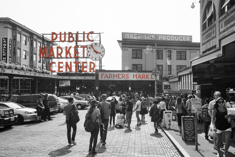 EyeEmNewHere Farmers Market PNW PNWonderland Pacific Northwest  PikePlaceMarket Seattle The Week On EyeEm Washington State Architecture Blackandwhite Building Exterior Communication Crowd Day Large Group Of People Men Outdoors People Real People Sony A6000 Street Text Walking Women