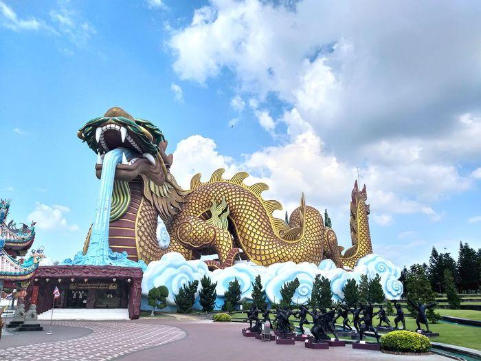 Statue against temple against sky