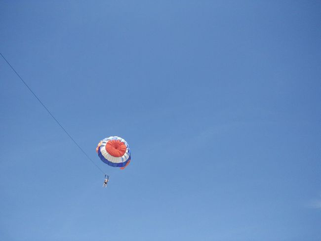 Adventure Beauty In Nature Blue Day Fun Low Angle View Mid-air Multi Colored Nature No People Outdoors Sky Tranquility Shore Bali, Indonesia Tanjungbenoa Nusadua Watersports Parasailing